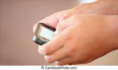 touchscreen mobile phone in the hands of a boy 2