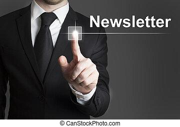 man in black suite pressing virutal button newsletter