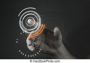 A man touching a futuristic button.