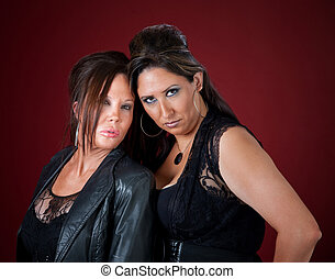 Two sexy middle-aged women in black pouting