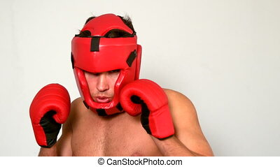Tough boxer punching with red glov - Tough boxer punching...