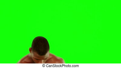 Tough boxer punching with red gloves on green screen...