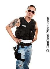 Tough Cop - Tough Latino cop in jeans and a bulletproof vest