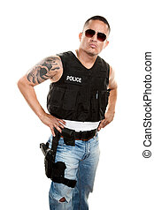 Tough Cop - Tough Latino cop in jeans and a bulletproof vest