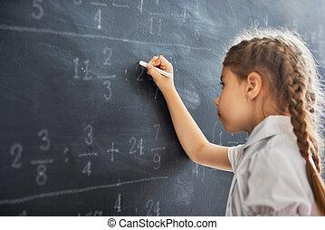 child near the blackboard - Tough day at school! Cute child...