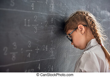 Sad child near the blackboard - Tough day at school! Sad...