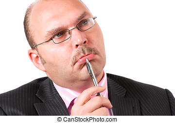 Tough decisions - Businessman in a thoughtful position on...