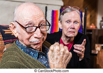 Tough Elderly Couple - Tough elderly couple indoors with...