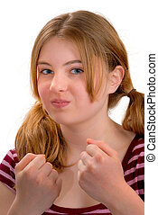 Tough Girl - Attractive teenage girl with fist up looking...