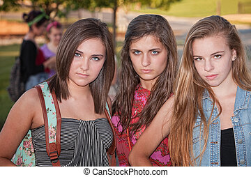 Tough Girls Outside - Trio of tough stylish teenage female...