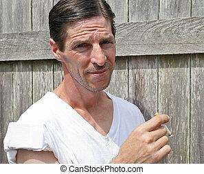 Tough Guy Smoking - A rough looking man smoking a cigarette...