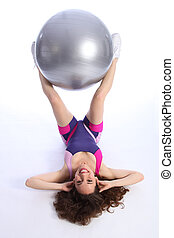 Tough workout by woman using fitness exercise ball