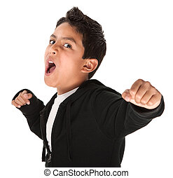 Tough Youngster - Young Hispanic kid showing fist and ready...