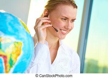Tour agent - Portrait of smiling tour agent with headset...