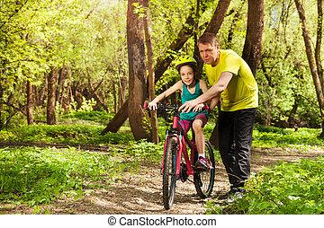 tour bicyclette, père, dehors, fille, enseigne