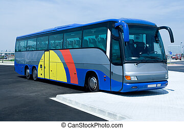 Tour Bus - A big tour bus waiting in the parking lot
