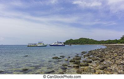 Tour cruiser anchor near the island