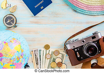 Tour planing conceptual image on blue wooden background