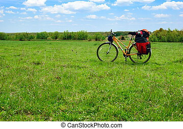 Touring bicycle - Loaded touring bicycle on rest break in...