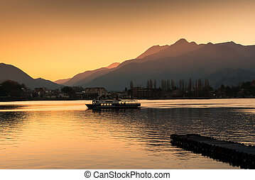 Touring Boat in Lake Kawaguchi at sunset, Japan