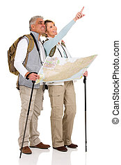 touring couple sightseeing with map