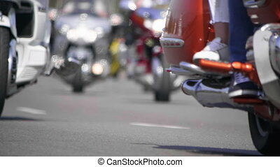 Touring motorcycles. Bottom view of a Bikers riding