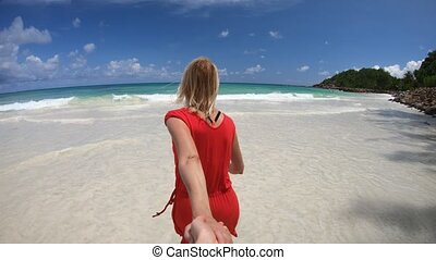 Tourism at Anse Kerlan - Follow me. Happy tourist woman...