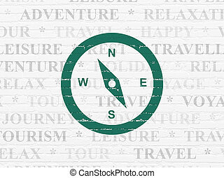 Tourism concept: Compass on wall background