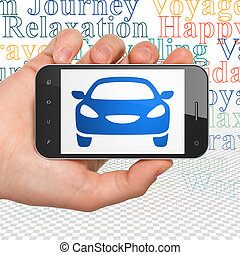 Tourism concept: Hand Holding Smartphone with Car on display