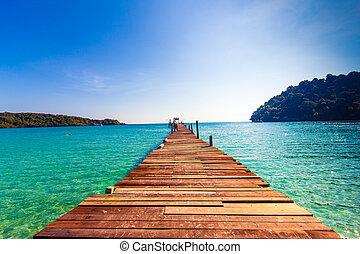 Tourism Concept. Old wooden pier. paradise island