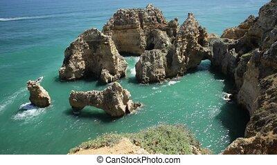 Tourism in Algarve. POV looking at amazing views of Ponta da...