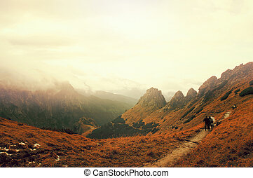 Tourists on the path in mountains, climing to the top of Giewont Mountain in Tatra Mountains., Poland.