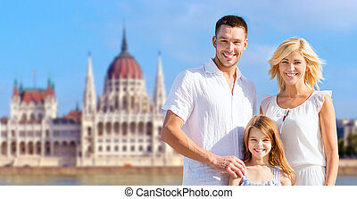 happy family over house of parliament in budapest