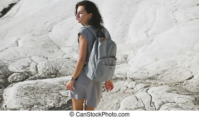 Tourism. young woman hiking in the mountains