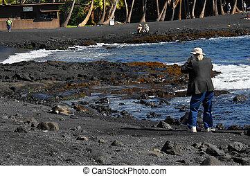Tourist Admires Turtles