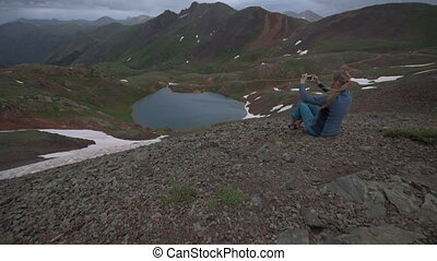 Tourist admires view from Hurricane Pass towards lake Como...
