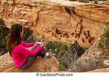 Tourist admiring Square Tower House, Mesa Verde National...