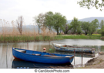 tourist and fisherman boats on lake ohrid in macedonia,...
