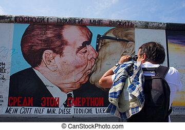 tourist at Berlin wall, Germany - tourist making photo at ...