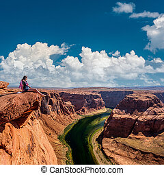 Tourist at Horseshoe Bend on Colorado River