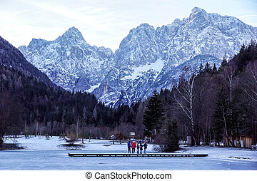 Tourist at Misurina lake sunset blue winter Dolomites Val di Funes valley, Italy. Aerial top view.