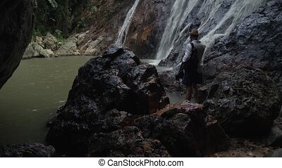 Tourist at Na Muang Waterfall on Koh Samui in Thailand stock...