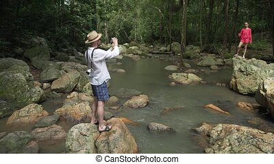 Tourist at Na Muang Waterfall on Koh Samui in Thailand stock footage video