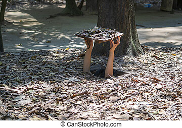 Tourist at the entrance of Cu Chi Tunnels in Ho Chi Minh, Vietnam, closeup