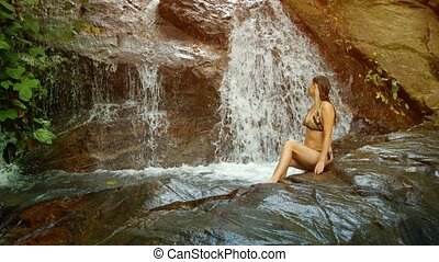Tourist bathing in the forest waterfall. Thailand, Phuket Island