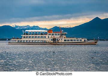 Tourist boat drives at Chiemsee in Bavaria, Germany.
