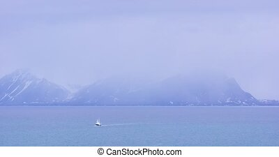 Tourist boat in the arctic environment near Svalbard -...