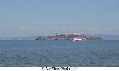 Tourist boat sails near the island of Alcatraz