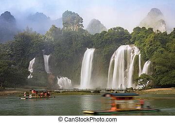 Tourist boats viewing Detian Waterfalls in Guangxi Province,...