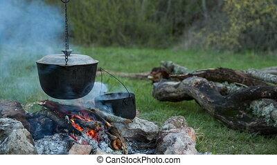 Tourist campfire. Preparing food
